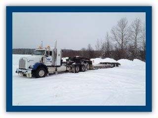 flat bed truck moving on a snow covered road
